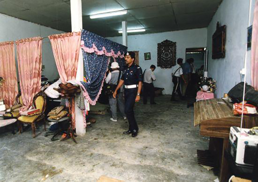 The police combing through Mona's house in Raub.