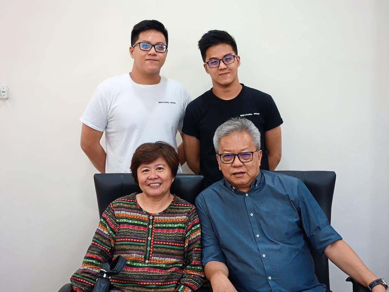 Proud Asian parents.