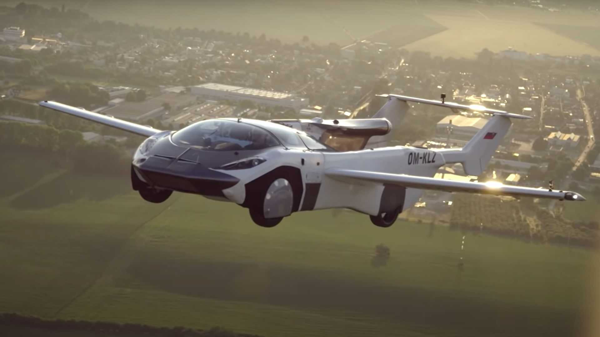 Sports car on road, plane on air.