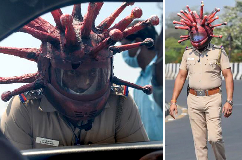 Indian Police Officer Wears 'Coronavirus Helmet' To Scare People From Coming Out