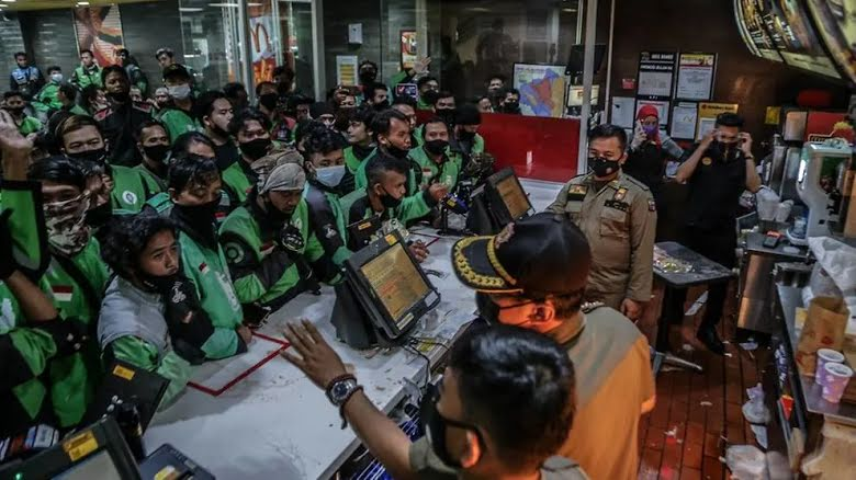Dozens of delivery riders raided McDonald's.