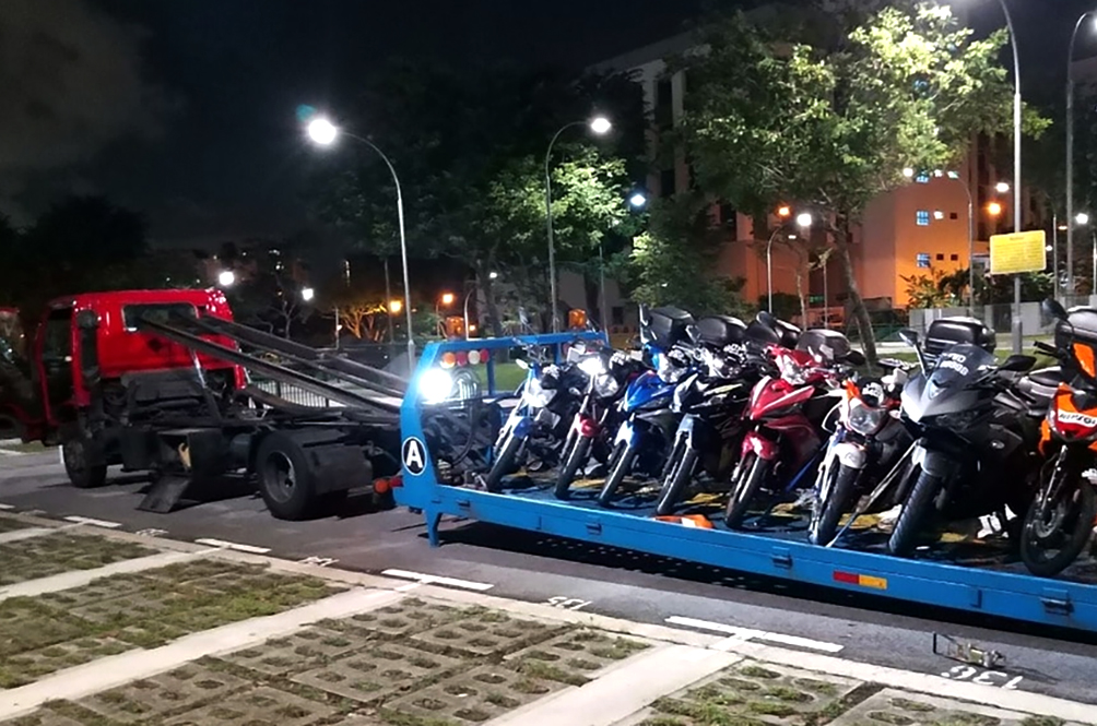 5,000 Motorcycles, Cars Towed Back To Malaysia Because It's Too Expensive To Keep Them In Singapore