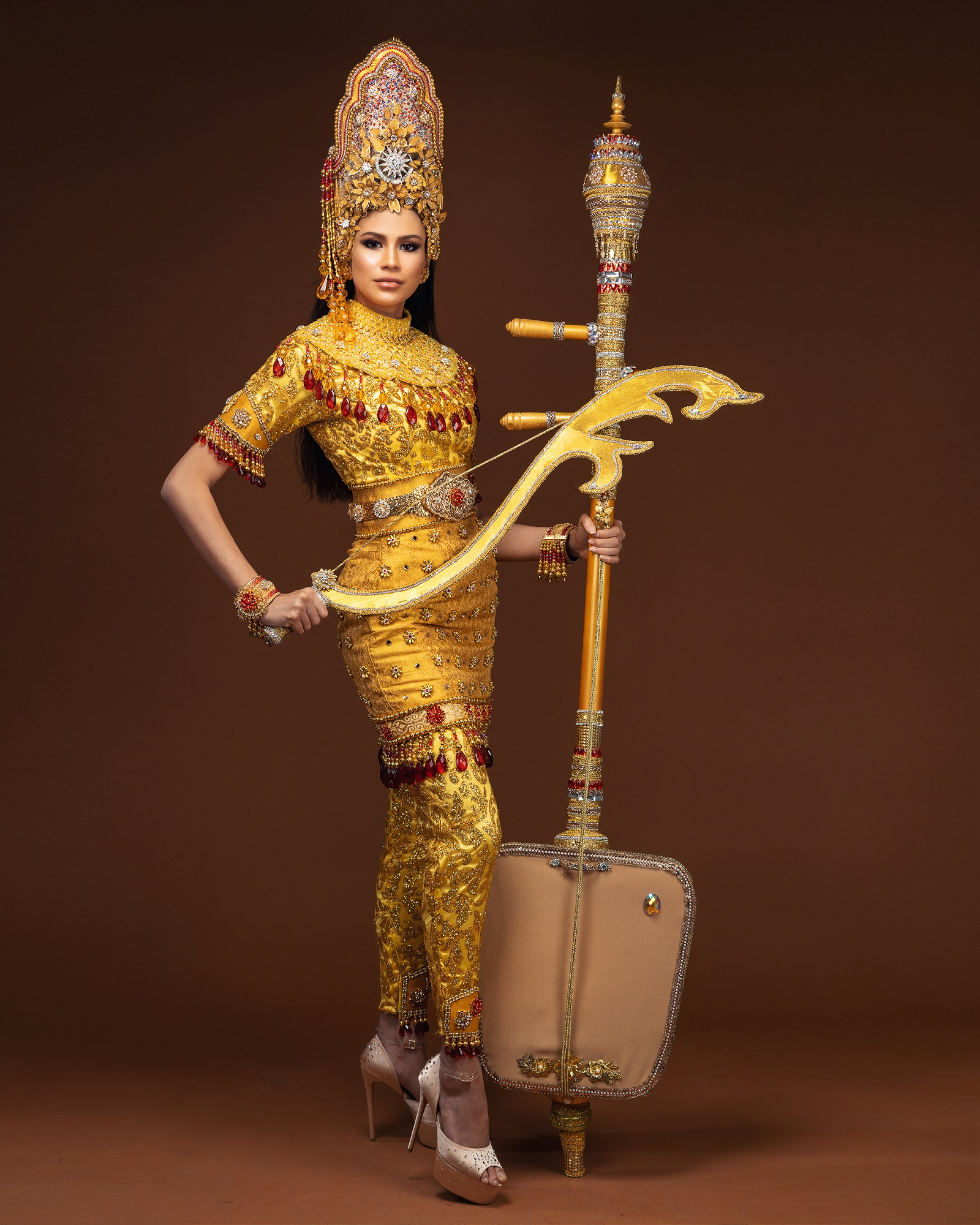 The costume was designed by Ain Mohamad from Kelantan.