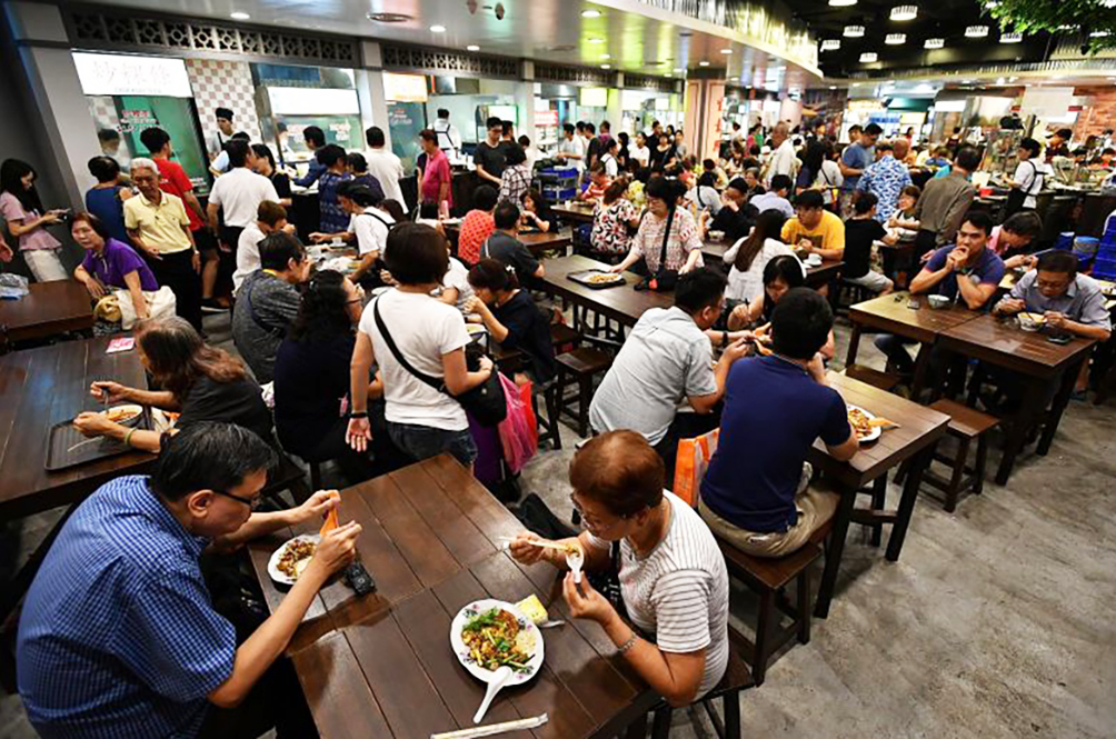 Senior Minister: Restaurants Can Now Sit More Than Four People Per Table