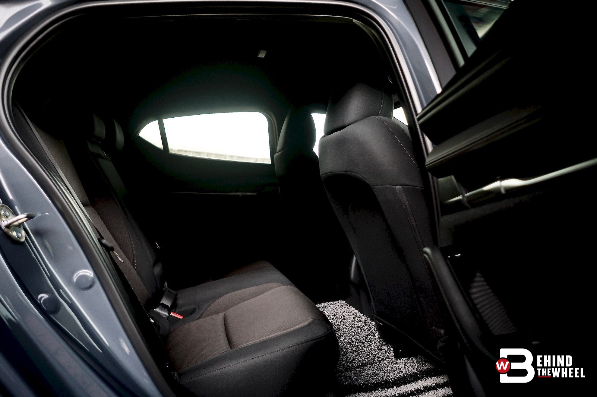 Tall people rejoice! The little notch in the front seats gives your knees more room.