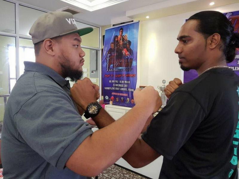 Dua peserta tempatan, Azreel Izzat Al-Hadi Azizul (kiri) dari Lekir Fight Team bersama Muhamad Sharil Ismail mewakili Pertubuhan Belia Liga Muslim Warrior bakal beraksi dalam Kejohanan Pusaka Ultimate Fight 2017.