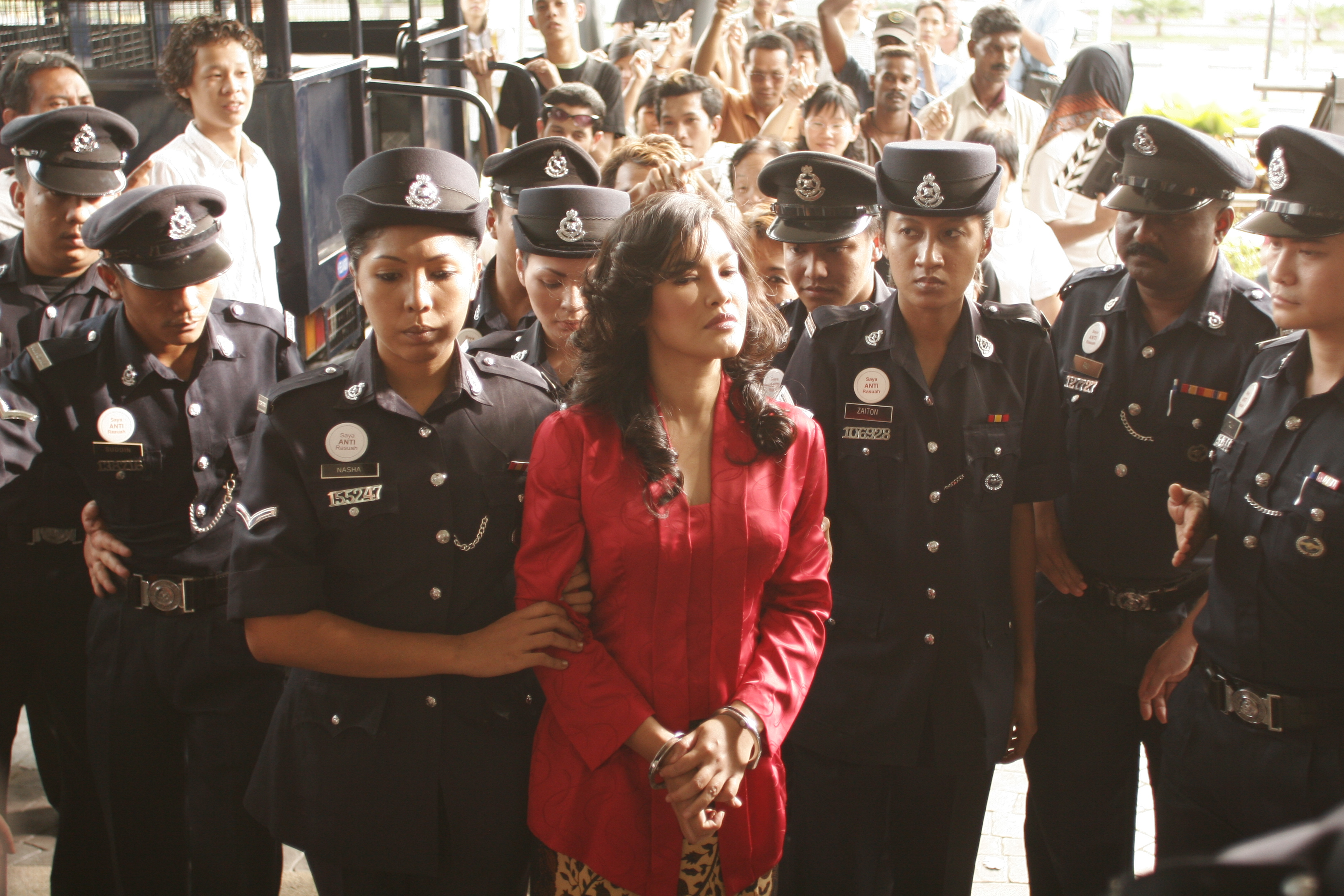 Diana donning her iconic red kebaya for a court hearing.