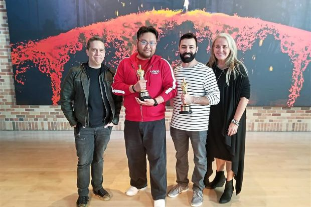 Lyon holding the Oscar with Coco's director Lee Unkrich, co-director Adrian Molina and producer Darla K. Anderson.