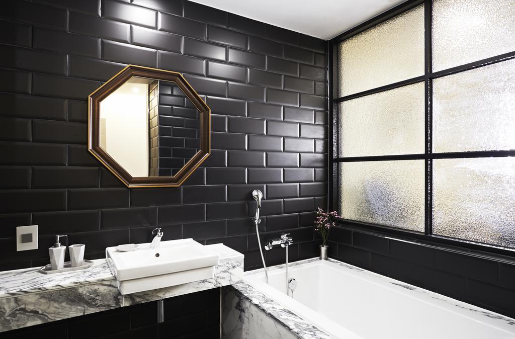 A pretty bathroom to match your dark soul.