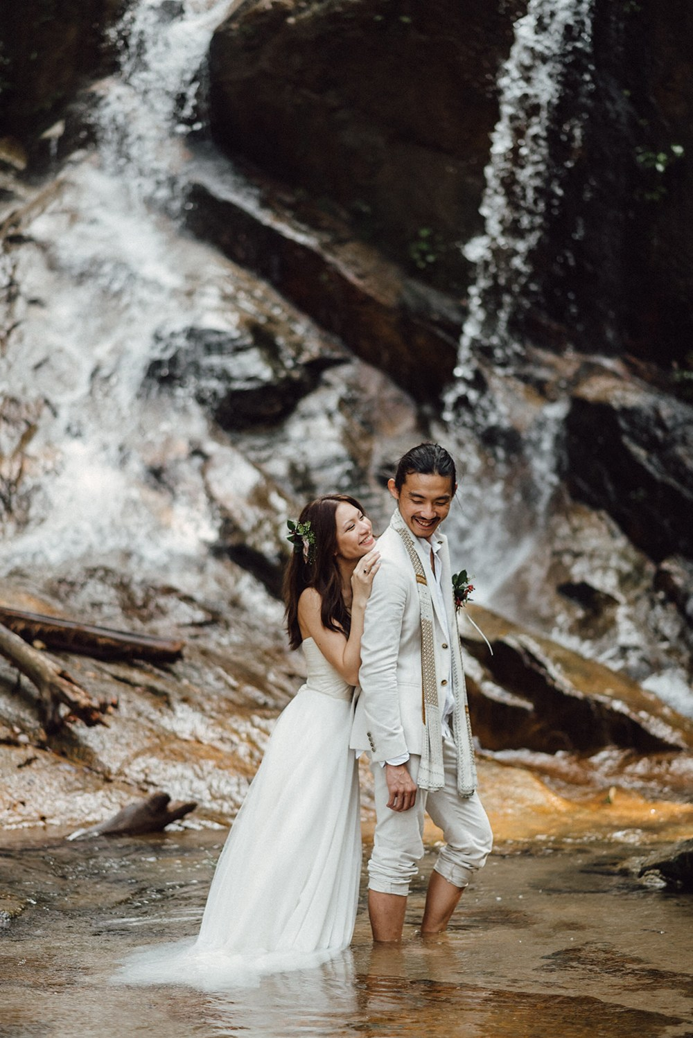 That waterfall backdrop is definitely to die for! #WeddingGoals
