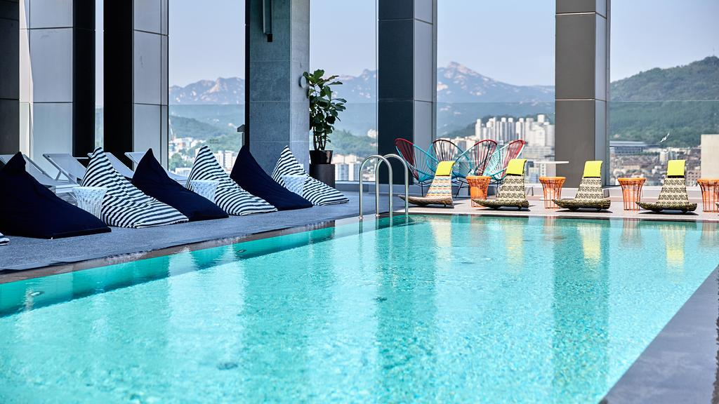 Just imagine yourself lazing around this rooftop pool.