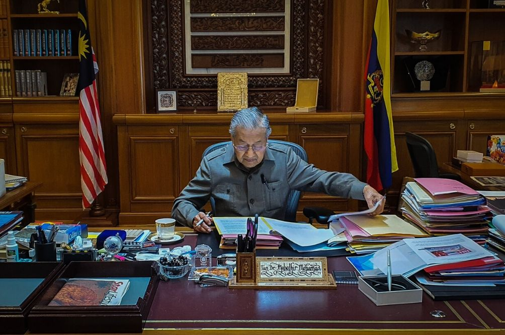 Keep Calm And Carry On: Tun Mahathir Shares Photos Of Him Back In Office As Interim PM