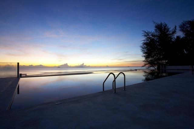 Drop dead sunset against the infinity pool and South China Sea.
