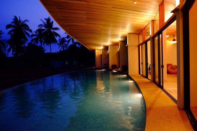Towering coconut trees, beautiful sunsets, and an awesome pool. Perfect!