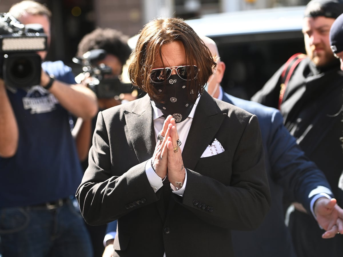 Depp arriving in court for his trial.
