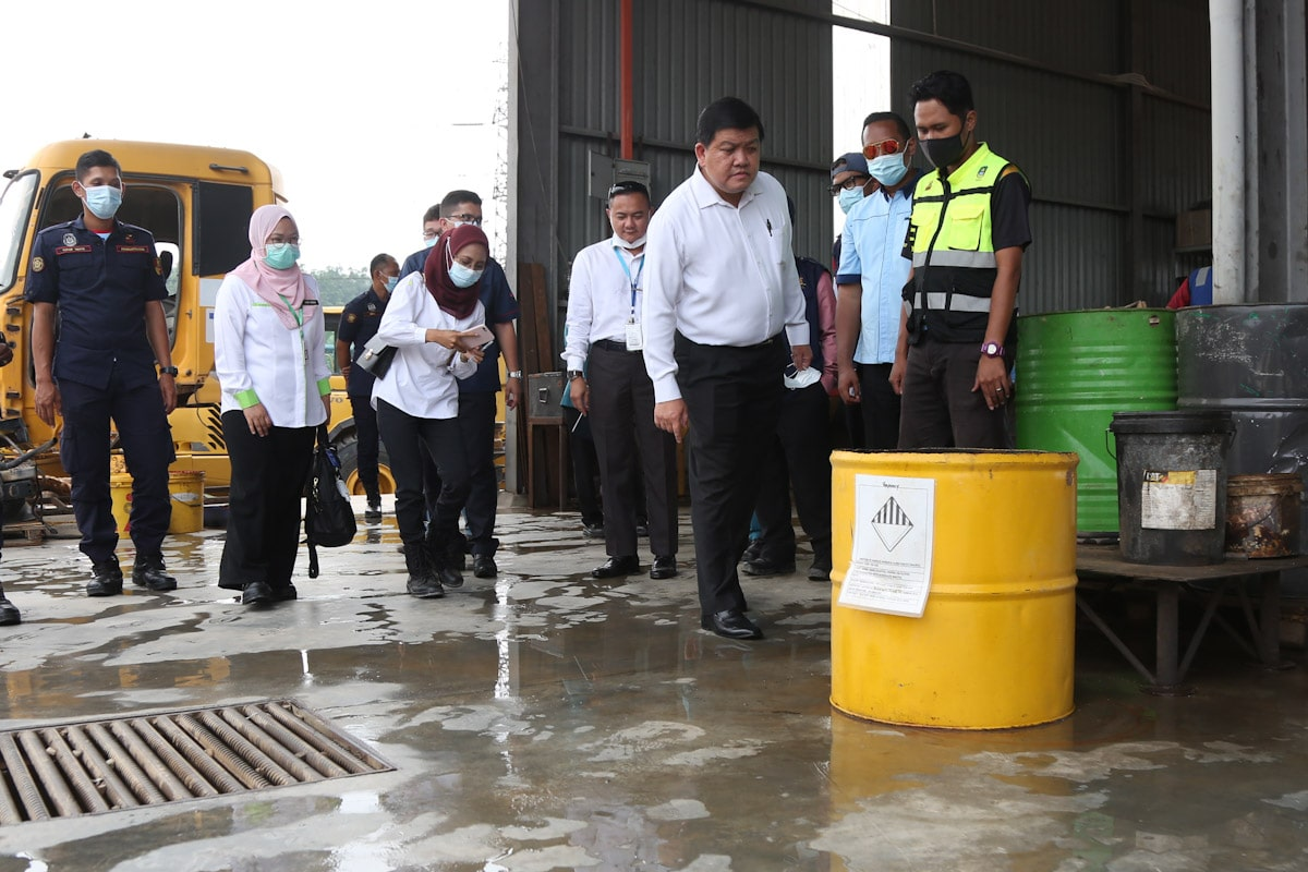 Authorities inspecting a heavy machinery maintenance plant in Rawang.