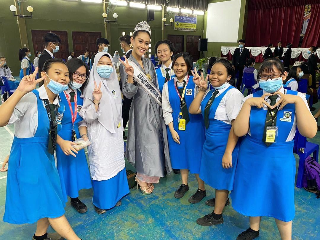 Francisca visiting students at SMK Muara Tuang.