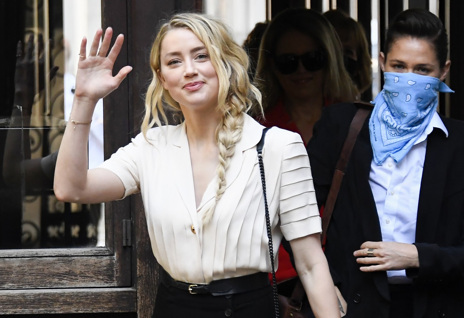 Amber Heard arrives at the High Court in London on Monday to testify in Johnny Depp's libel trial against the Sun tabloid.