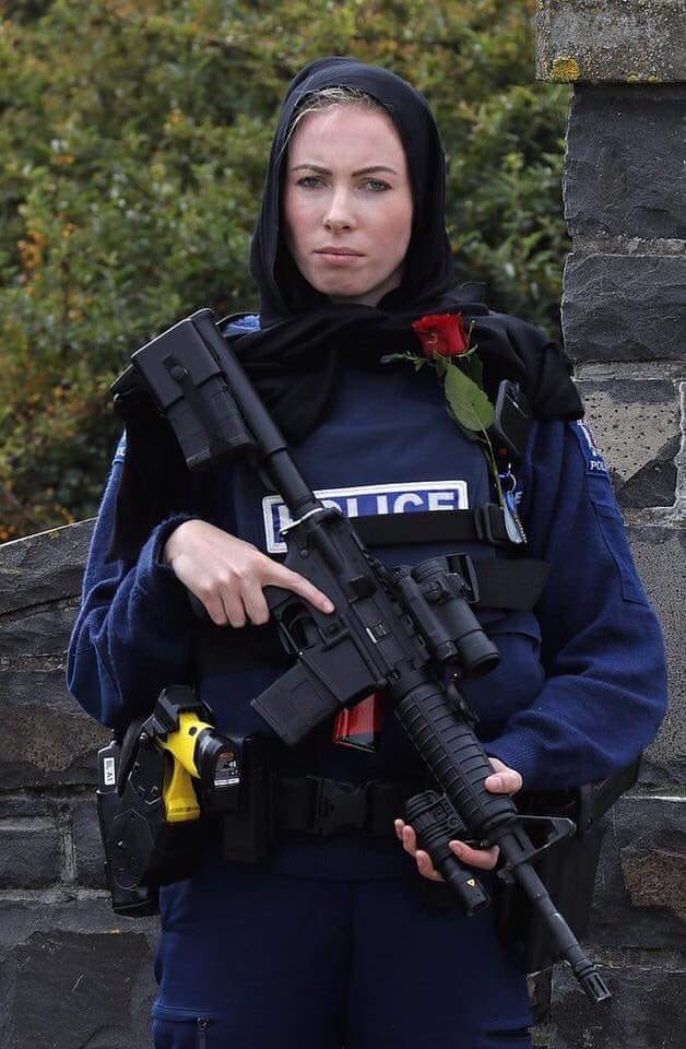 A female New Zealand police officer wearing the hijab to support the cause.
