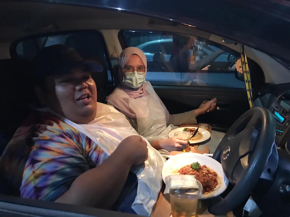 Customers enjoying their meal.