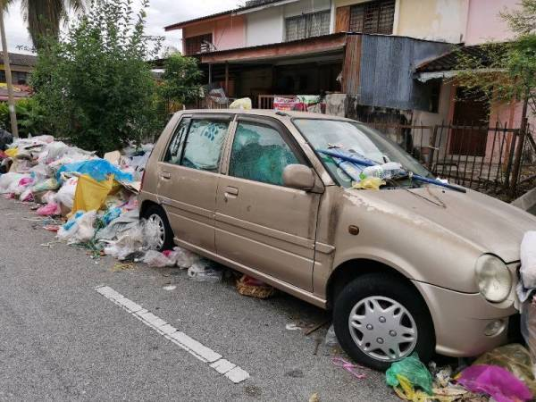 Even her car is full of rubbish.
