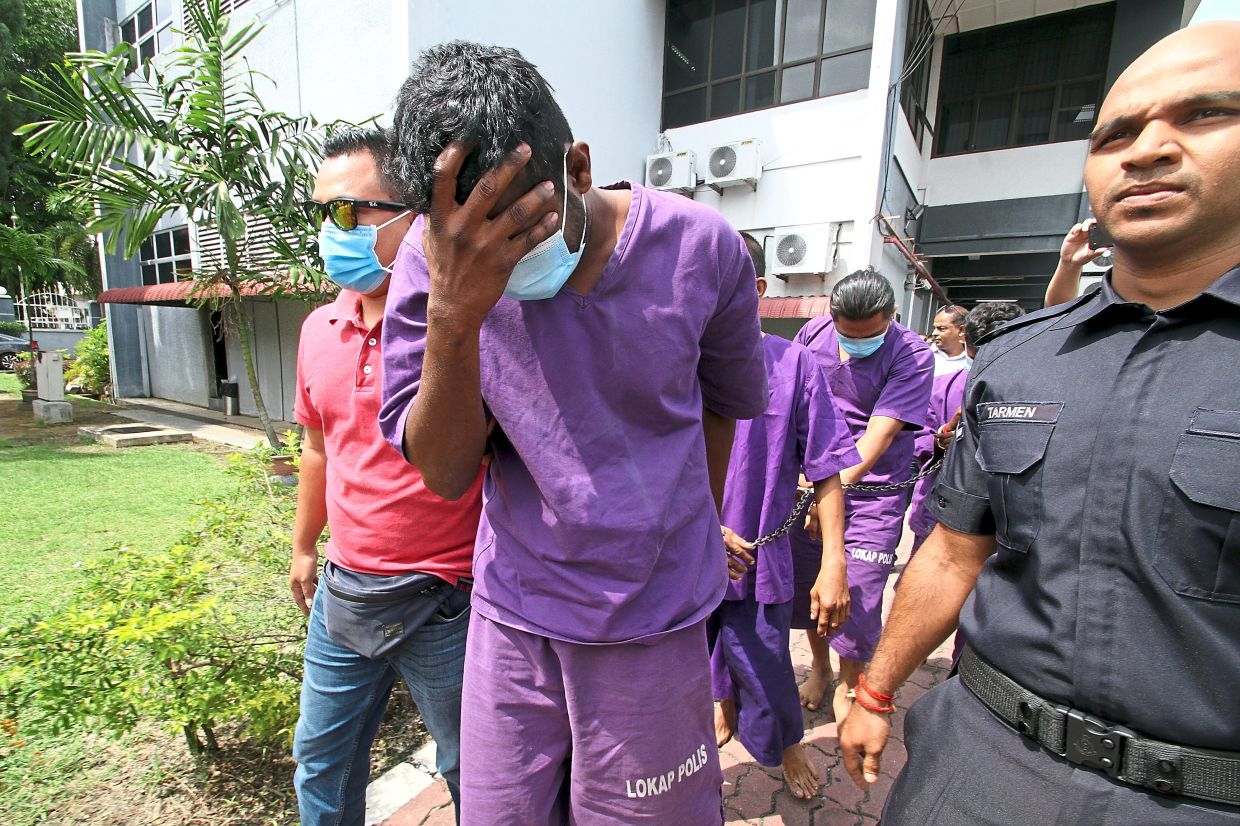 Sugu being brought to the Magistrate's Court in Ipoh.