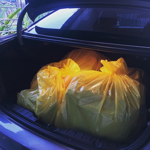Patients' luggages and items being wrapped in the yellow biohazard/ clinical waste plastic bag.