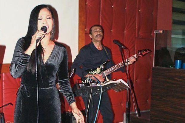Lyia and her husband, Zack performing.