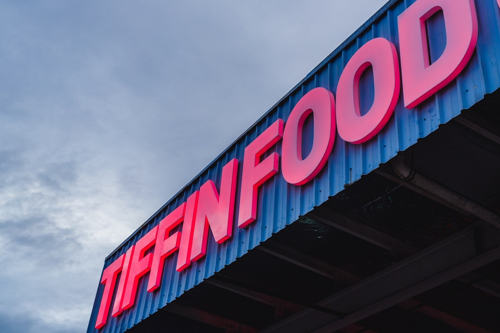 The former electronics manufacturing warehouse was transformed into a tasteful neon-wrapped food court.