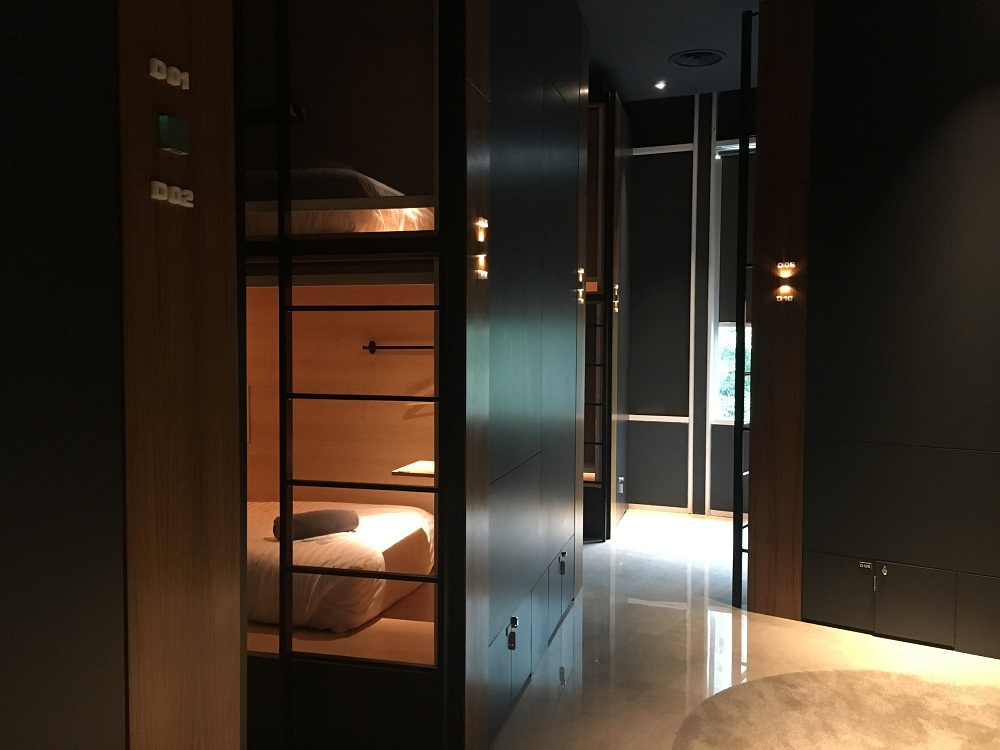 The sharing room for single pods looks more like a luxury budget hotel.
