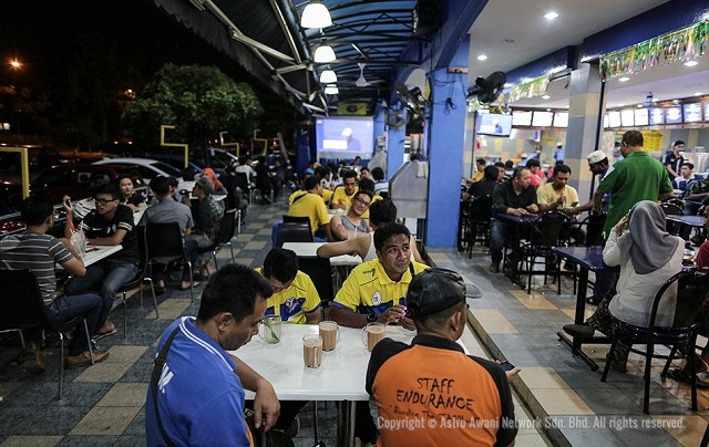 Customers waiting for food at a mamak restaurant in Shah Alam.