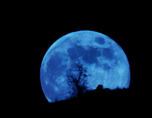 An older definition describes a blue moon as the third of four full moons in a single season