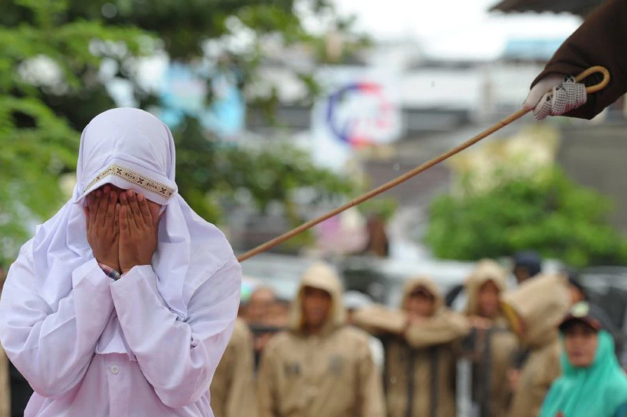 This picture depicts a Muslim women being caned in Acheh, Indonesia, where public caning has been implemented for nearly 20 years.