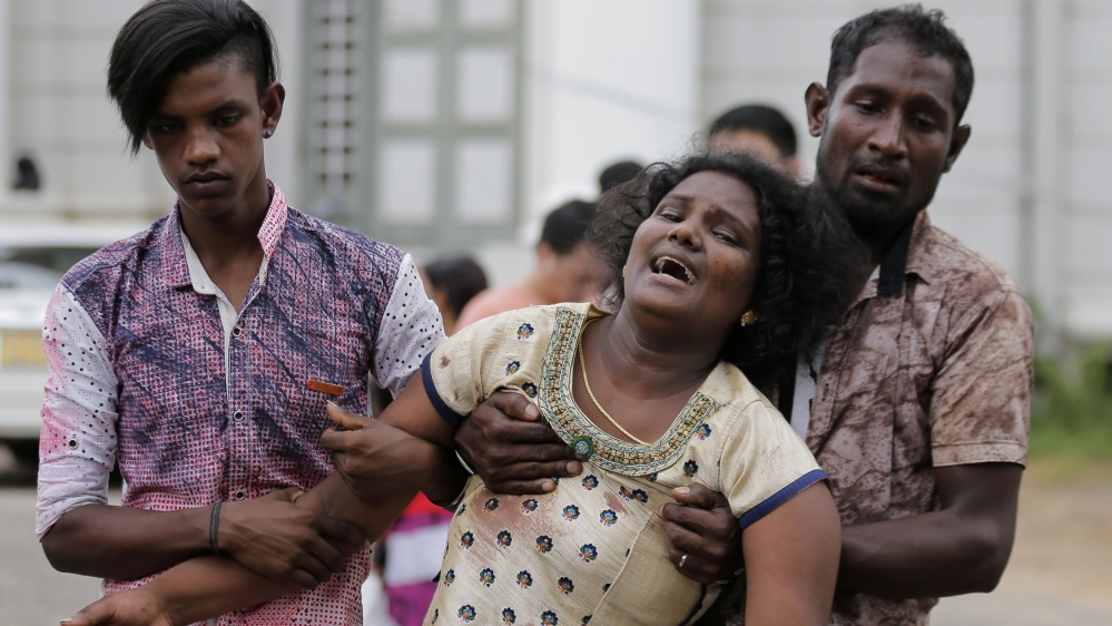 Victim's relatives outside a morgue in Colombo.