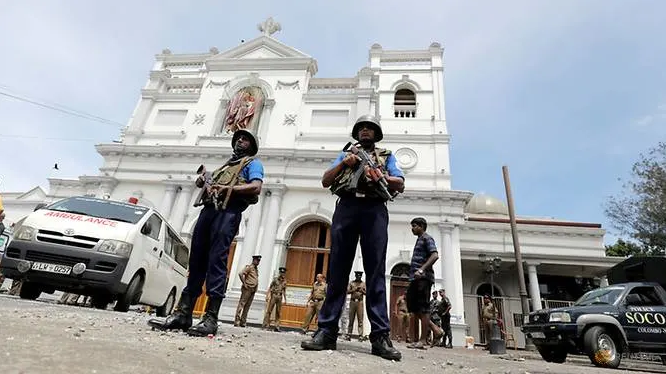 Sri Lankan military officials guarding the front of the St Anthony's Shrine.