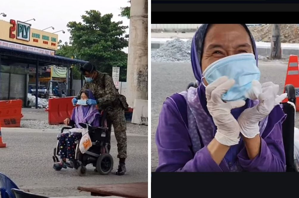 #MYHero: Malaysian Soldier Captured On Video Helping Lone Disabled Woman Put On Mask And Gloves