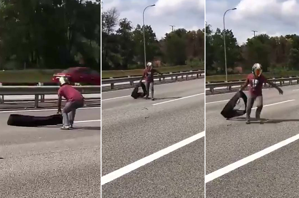 Malaysian Motorist Risks His Life To Pick Up Debris On The Highway