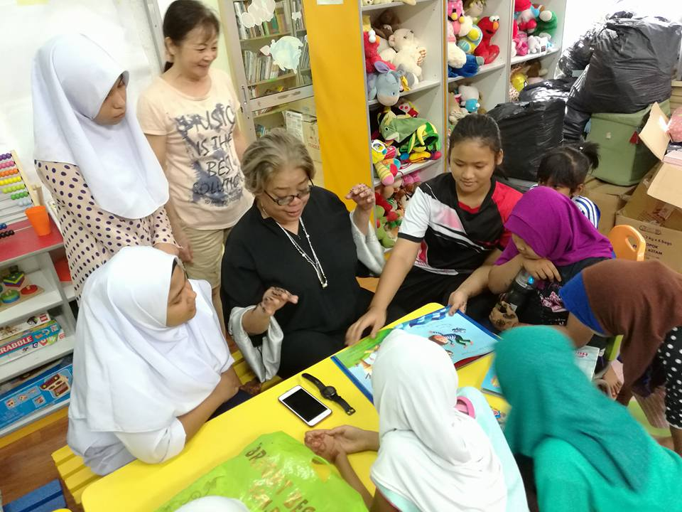 Dr. Hartini in action with the children.