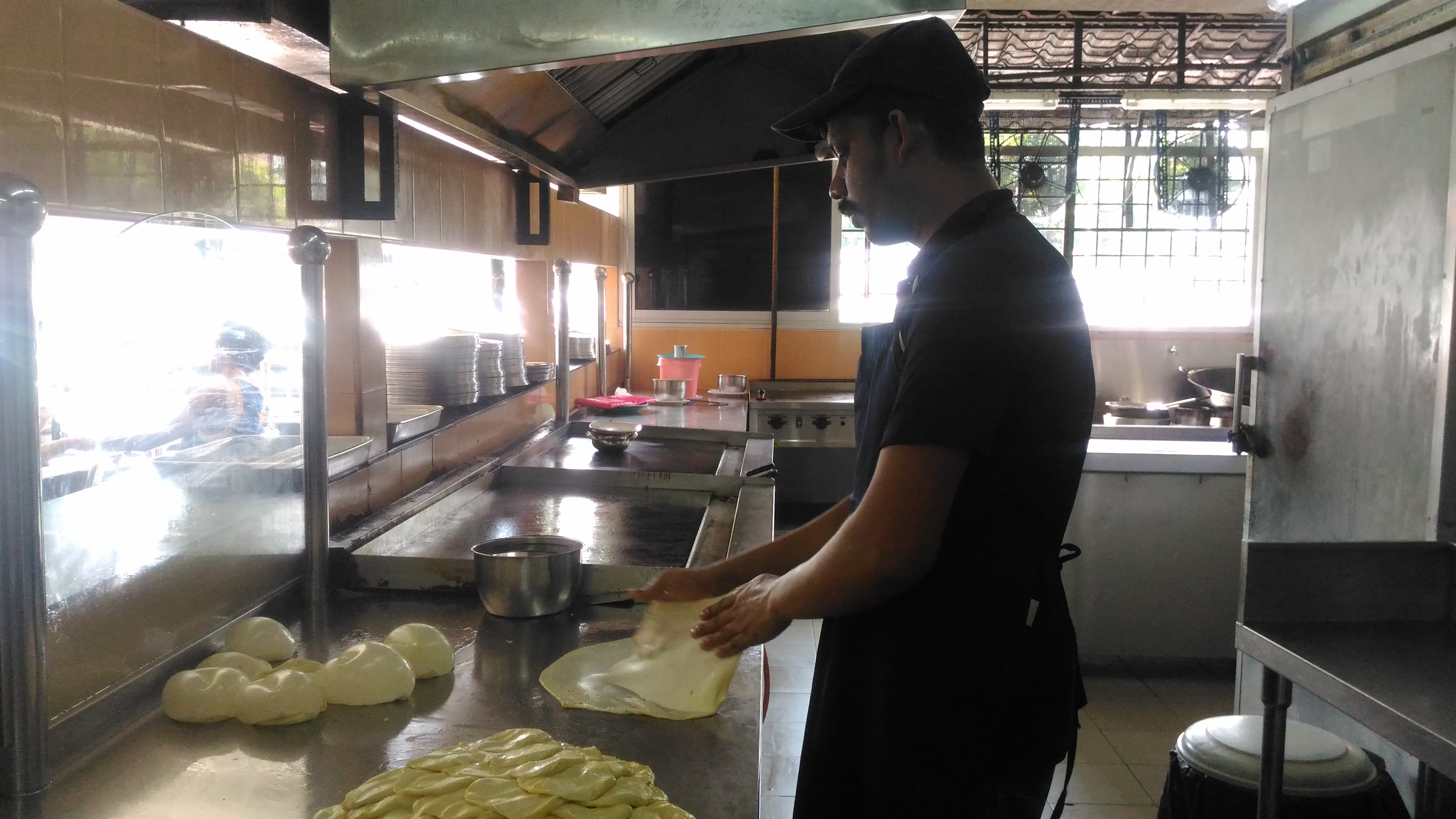 The fine art of tossing roti canai!