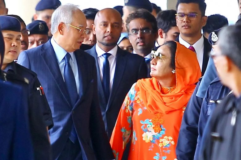 Najib and Rosmah during one of the 1MDB trials