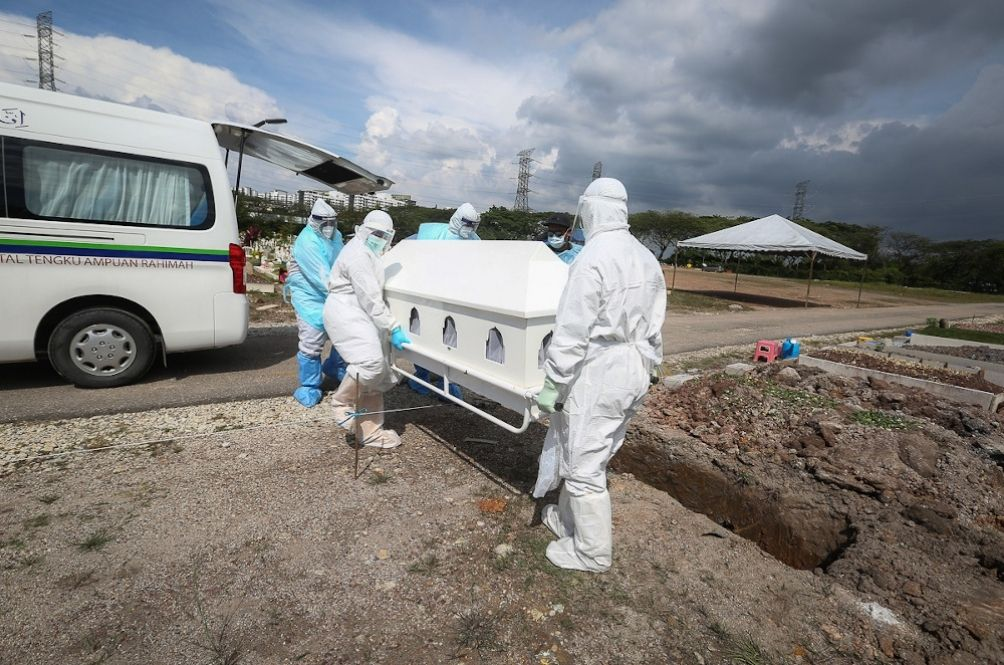 Long Wait For Bodies To Receive Last Rights As COVID-19 Death Toll Rises In Malaysia