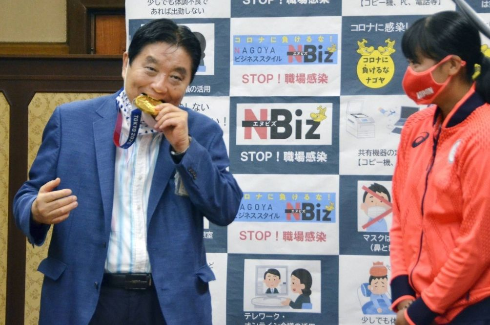 Japanese Mayor Who Bit Into Gold Medal Of Olympian Tests Positive For Covid-19
