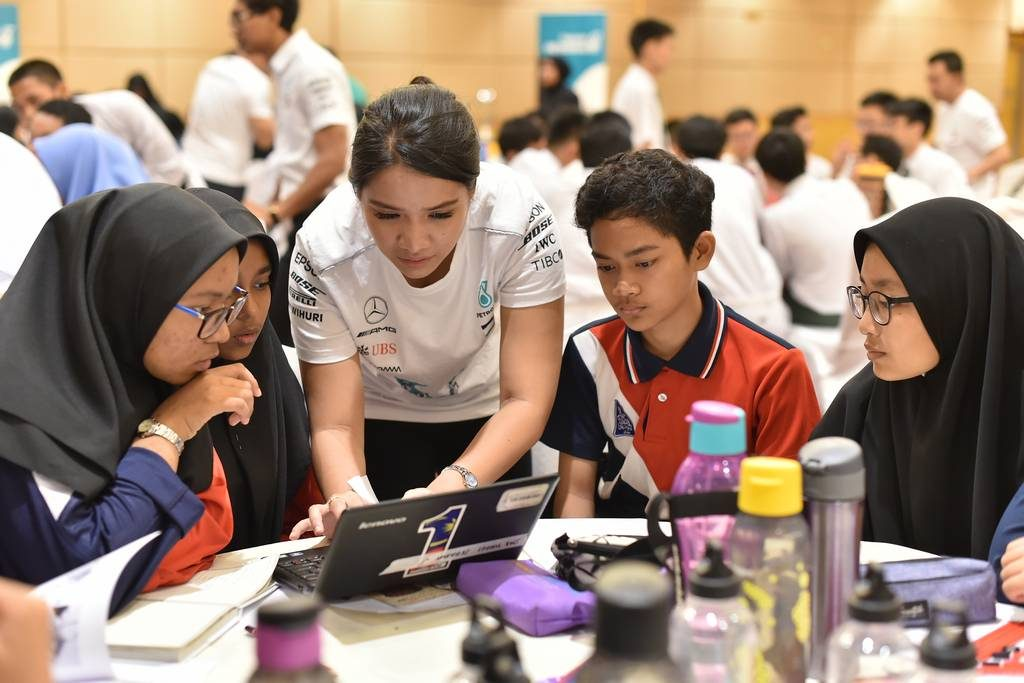 Petronas volunteer helping some of the students