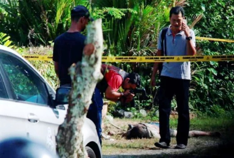 Police at the crime scene in Bukit Mertajam