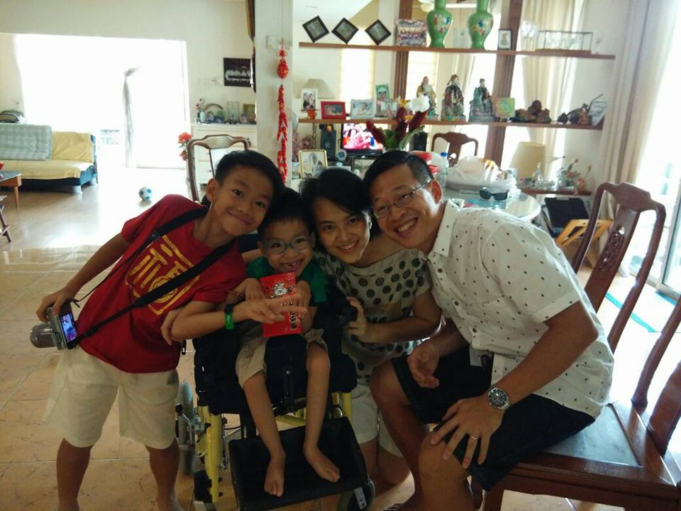 weCAREjourney founders Edmund Lim and Yap Sook Yee with their sons Jaden and Branden