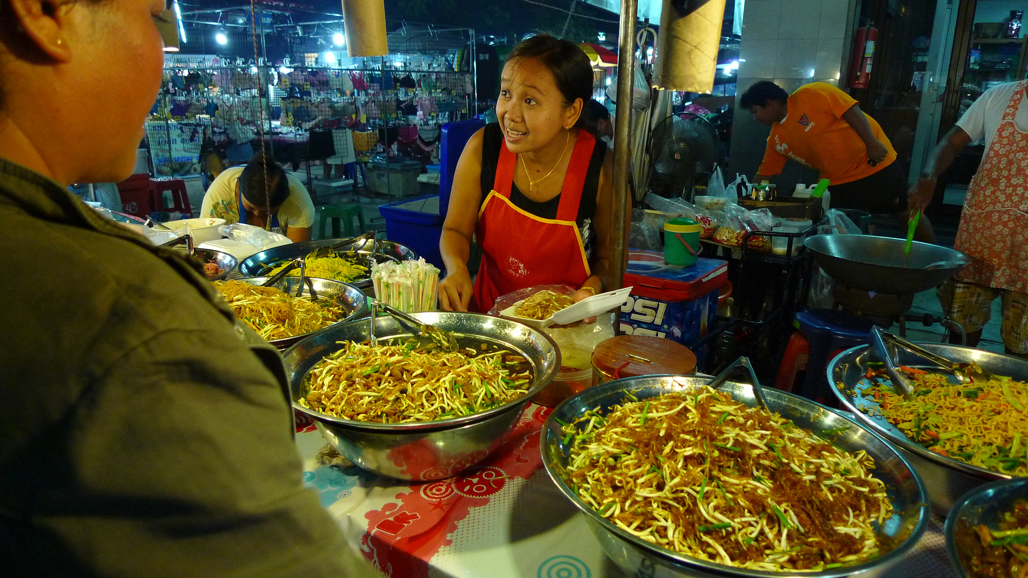 Stretch of noodles at night market.