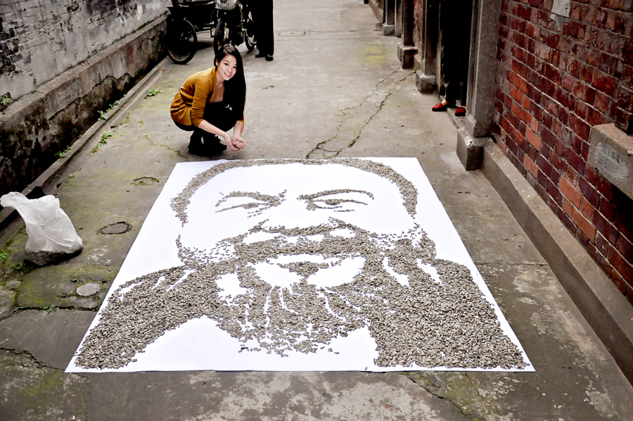Red created a portrait of Chinese artist Ai Weiwei in the alleyway next to her home in Shanghai.