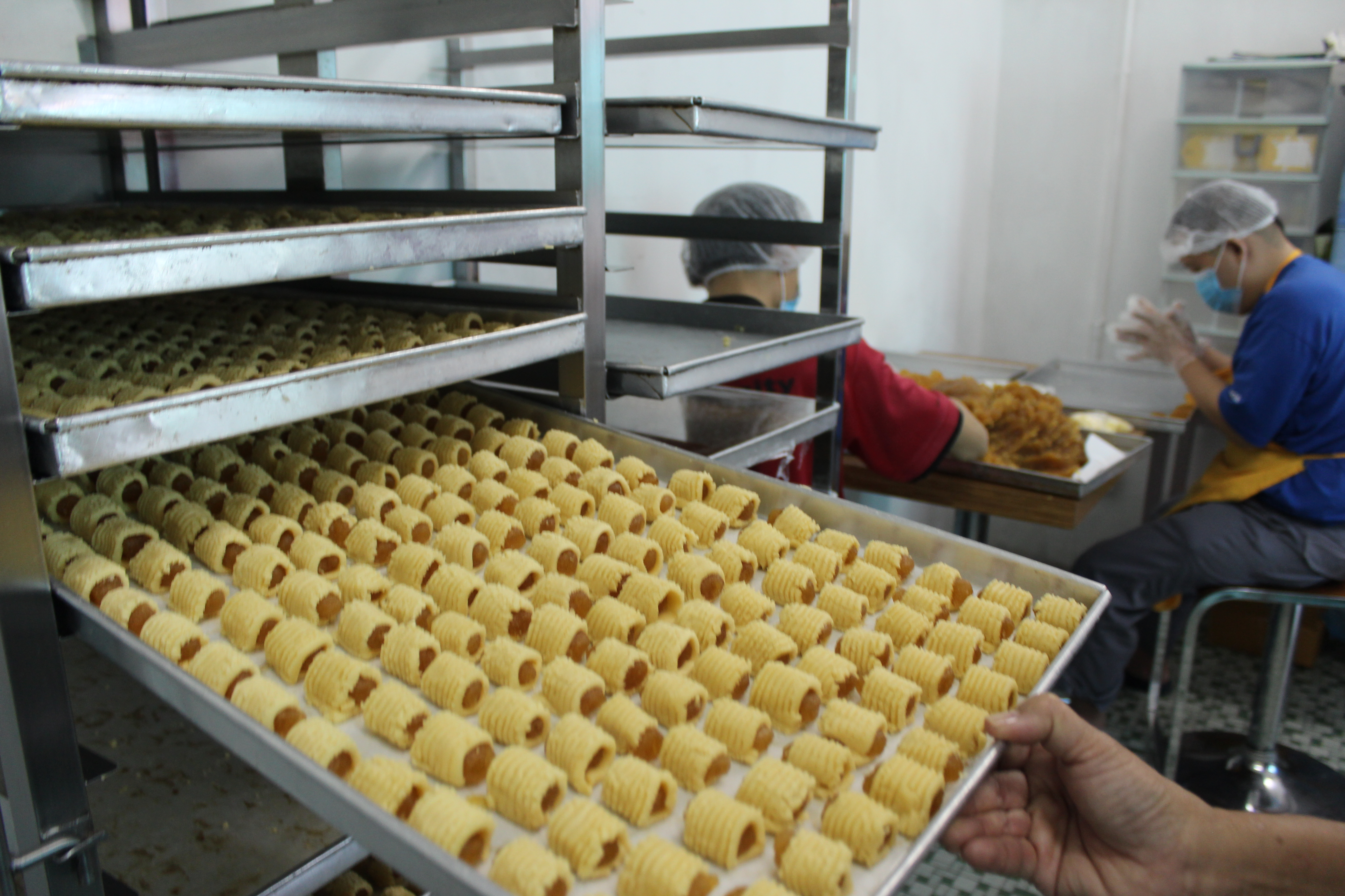Rolling thousands of pineapple tarts is no easy feat.